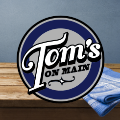 logo design Tom's on Main